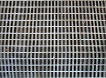 Texture of old perforated metal Stock Photo