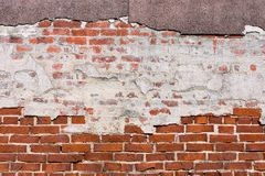 Texture of an old red brick wall with destroyed plaster Royalty Free Stock Photo