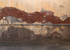 Texture of old red brick walls with  plaster Stock Photography