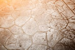 Texture of the old road with cracks. Asphalt surface on the street. Glare of light.  Royalty Free Stock Image