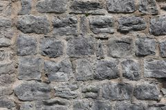 Texture - Old rock medieval fortress wall royalty free stock images