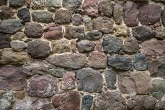 Texture of old rock wall for background, Medieval stone wall.  royalty free stock photo