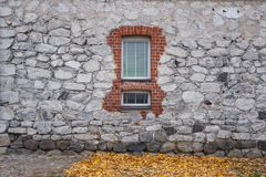 Texture of old rock wall for background with window Stock Photo