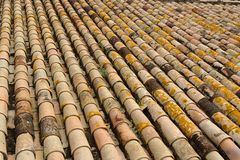 Texture of old roof tiled with cylindrical tiles Royalty Free Stock Images