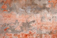 Texture of old rustic wall covered with pink stucco Stock Images