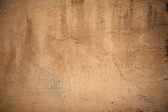 Texture of old rustic wall covered with yellow stucco Stock Photo