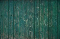 The texture of an old rustic wooden fence made of flat processed. Boards. Detailed image of a street fence of a rustic type made of wooden material close-up Stock Photos