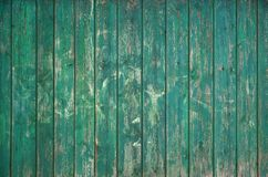The texture of an old rustic wooden fence made of flat processed boards. Detailed image of a street fence of a rustic type made o. F wooden material close-up Royalty Free Stock Image