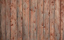 The texture of an old rustic wooden fence made of flat processed boards. Detailed image of a street fence of a rustic type made o. F wooden material close-up stock photography