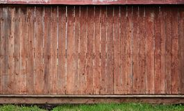 The texture of an old rustic wooden fence made of flat processed. Boards. Detailed image of a street fence of a rustic type made of wooden material close-up Royalty Free Stock Images