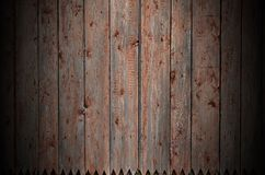 The texture of an old rustic wooden fence made of flat processed. Boards. Detailed image of a street fence of a rustic type made of wooden material close-up Royalty Free Stock Image