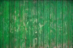 The texture of an old rustic wooden fence made of flat processed boards. Detailed image of a street fence of a rustic type made o. F wooden material close-up Royalty Free Stock Photos