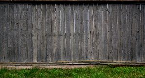 The texture of an old rustic wooden fence made of flat processed boards. Detailed image of a street fence of a rustic type made o. F wooden material close-up Stock Photo