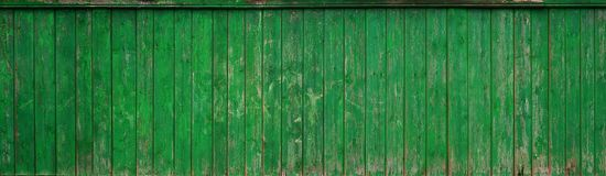The texture of an old rustic wooden fence made of flat processed boards. Detailed image of a street fence of a rustic type made o. F wooden material close-up Stock Images