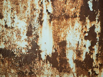 Texture of old rusty metal with streaks of rust and cracked, flaking paint. Surface of rusty metal close-up with old and Stock Image