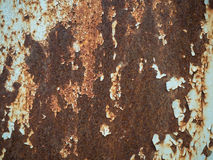Texture of old rusty metal with streaks of rust and cracked, flaking paint. Surface of rusty metal close-up with old and Stock Photo