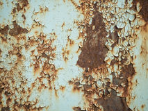 Texture of old rusty metal with streaks of rust and cracked, flaking paint. Surface of rusty metal close-up with old and Royalty Free Stock Photography