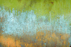 Texture of old rusty shabby background with scratches. With the remains of green and blue paint Stock Image