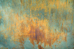 Texture of old rusty shabby background with scratches. With the remnants of blue paint Royalty Free Stock Photography