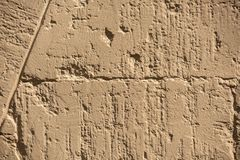 The surface of the old wall. The texture of the old shabby wall from old bricks, broken, stone, dirty, hole, cracked, abandoned, grunge, wallpaper, retro, block royalty free stock images