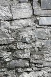 Texture of old stone wall. The texture of the old stone wall for a background painted with silver paint stock photo