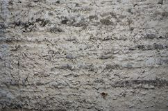 The texture of the old stone wall, carelessly treated with cement morta. R Stock Image