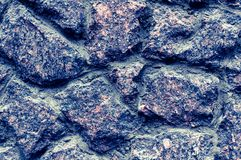 Texture of old stone wall. Great design for any purpose. Photo toned in beautiful blue tones royalty free stock photography