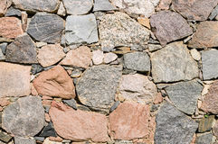 Texture of old stone wall of large rough boulders Stock Photo