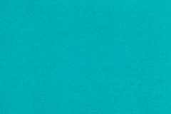 Texture of old turquoise paper closeup. Structure of a dense cardboard. The blue background. Texture of old light blue paper closeup. Structure of a dense royalty free stock image