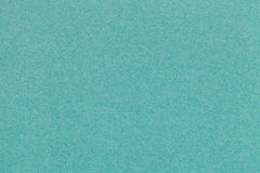 Texture of old turquoise paper closeup. Structure of a dense cardboard. The green background. Stock Photo