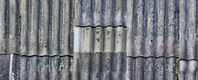 Texture of an old vintage roof covered with wavy aged asbestos t Royalty Free Stock Images