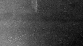 Background Of Film On Black Texture And White Scratches Stock Image