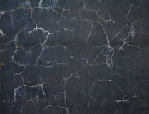 Texture of old wall covered with black stucco Stock Photos