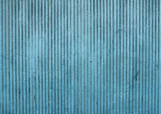 Texture of old wall covered blue stucco with vertical relief Royalty Free Stock Photo