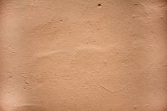 Texture of old wall covered with brown stucco Stock Photos