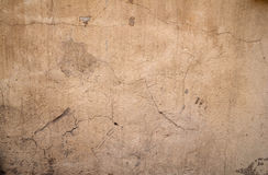 Texture of old wall covered with brown stucco Stock Images
