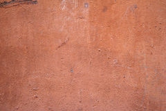 Texture of old wall covered with brown stucco Royalty Free Stock Image