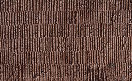 Texture of old wall covered with brown stucco Stock Image