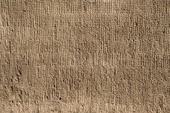 Texture of old wall covered with gray relief stucco Royalty Free Stock Image