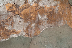 Texture of old wall covered with gray and yellow stucco Stock Photos