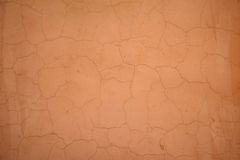 Texture of old wall covered with orange stucco Stock Images