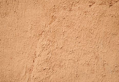 Texture of old wall covered with orange stucco Royalty Free Stock Photo