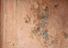 Texture of old wall covered with pink stucco Royalty Free Stock Photos