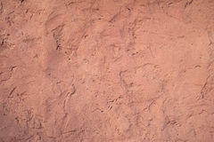 Texture of old wall covered with pink stucco Stock Images