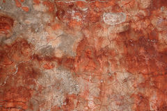 Texture of old wall covered with red stucco Royalty Free Stock Images