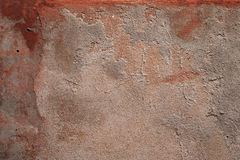 Texture of old wall covered with red stucco Stock Photography