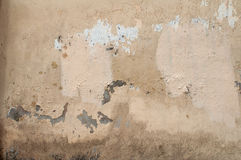 Texture of old wall covered with yellow stucco Stock Image