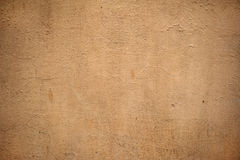 Texture of old wall covered with yellow stucco Royalty Free Stock Image