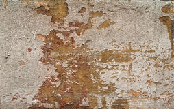 Texture of old wall covered with yellow stucco Stock Photos