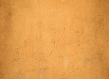 Texture of old wall covered with yellow stucco Stock Photography